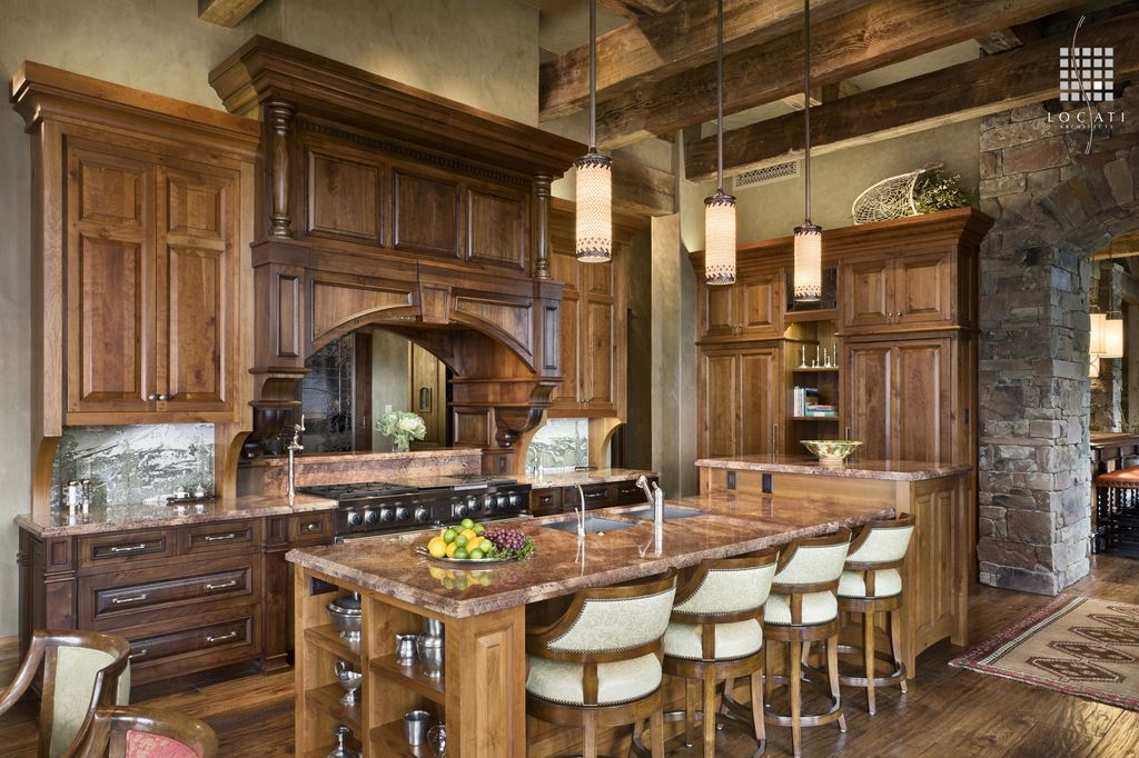 Country Kitchen with double oven range, Kitchen island, full backsplash, Textured plaster wall, Exposed beam, High ceiling