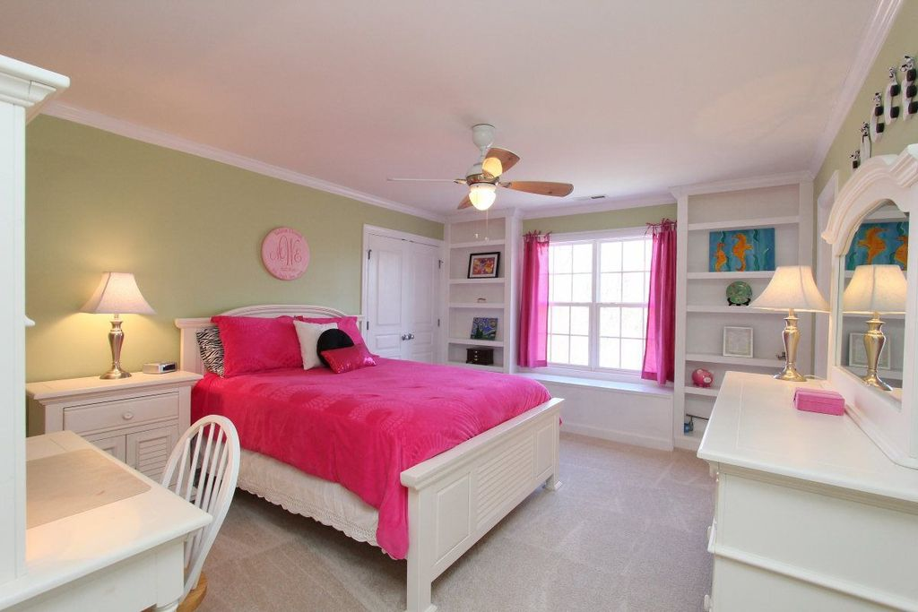 Traditional Kids Bedroom with Crown molding, Carpet, Standard height, double-hung window, Ceiling fan, Built-in bookshelf