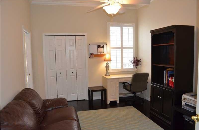 Traditional Home Office with Crown molding, Ceiling fan, Box ceiling, Standard height, Built-in bookshelf, Laminate floors