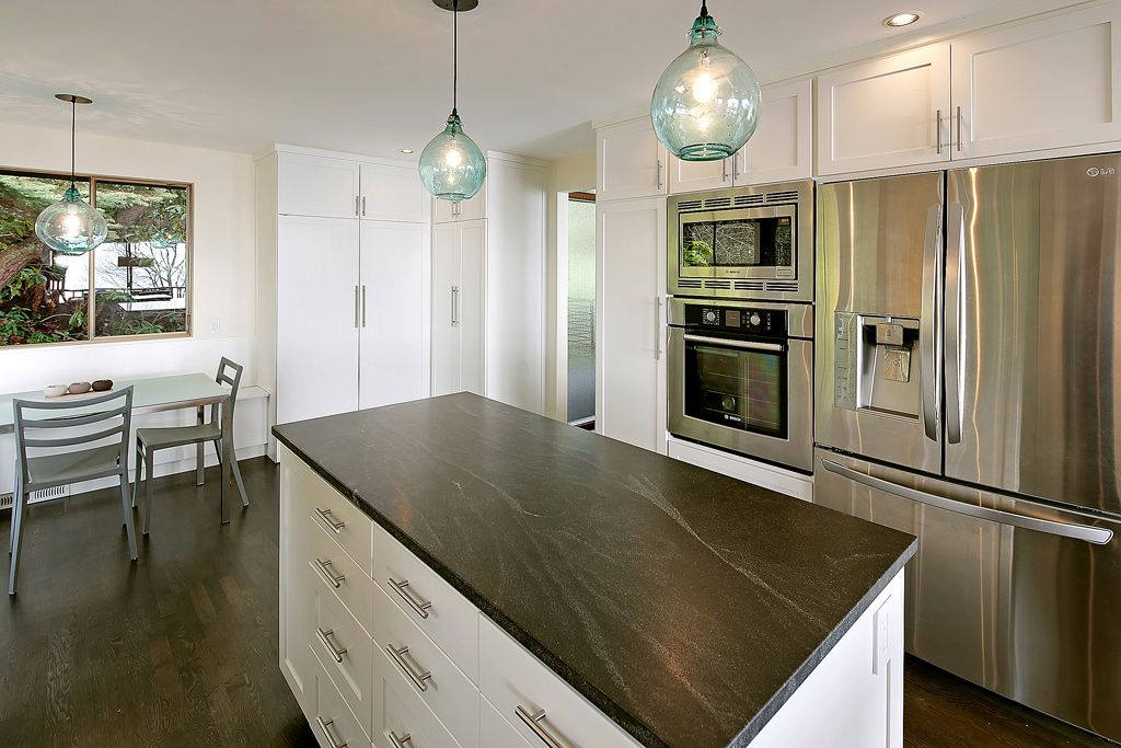 """Contemporary Kitchen with Casement, Soapstone counters, Pendant light, Flush, wall oven, 4"""" stainless bar pull, L-shaped"""