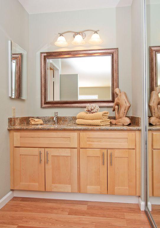 Contemporary Powder Room with Paint, Simple Granite, Simple granite counters, Hardwood floors, Standard height, Powder room