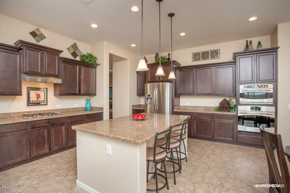 Traditional Kitchen with limestone tile floors, L-shaped, Breakfast nook, Msi granite countertops in amber yellow