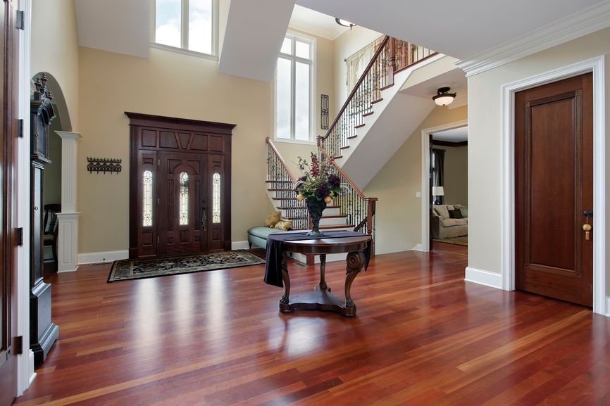 Traditional Entryway with Glass panel door, High ceiling, Hardwood floors, picture window