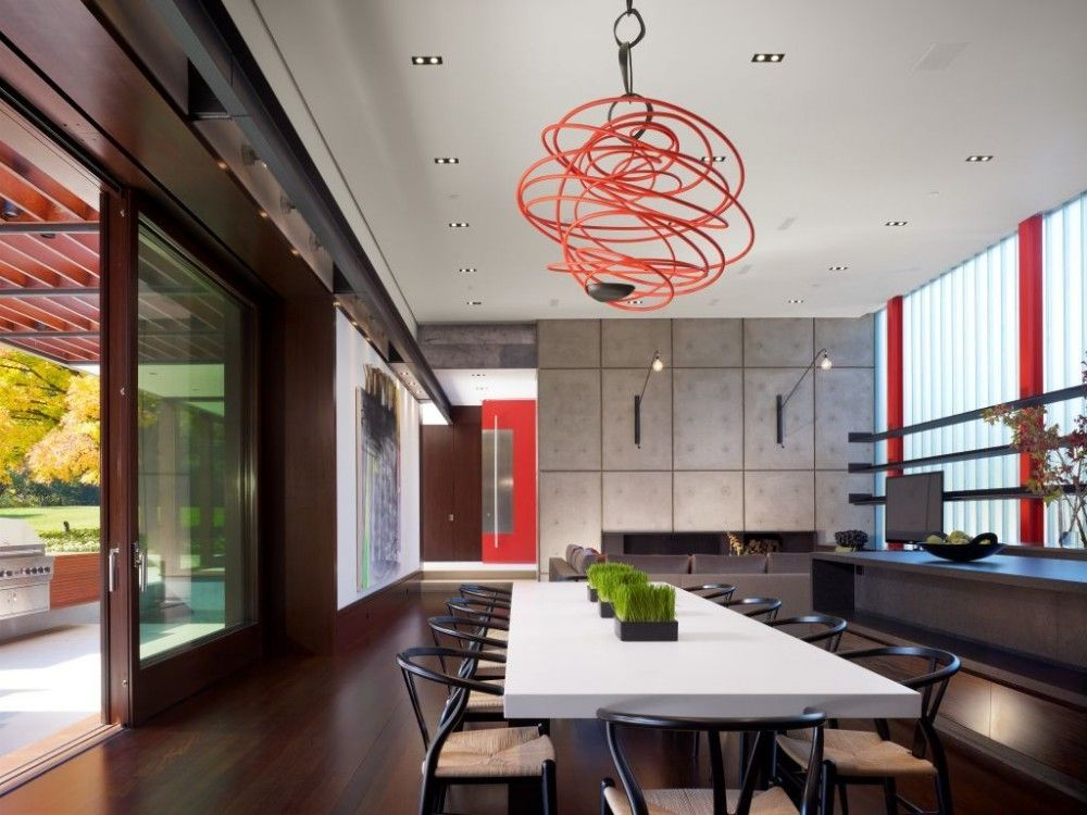 Contemporary Dining Room with specialty window, Built-in bookshelf, Wall sconce, Standard height, can lights, Chandelier