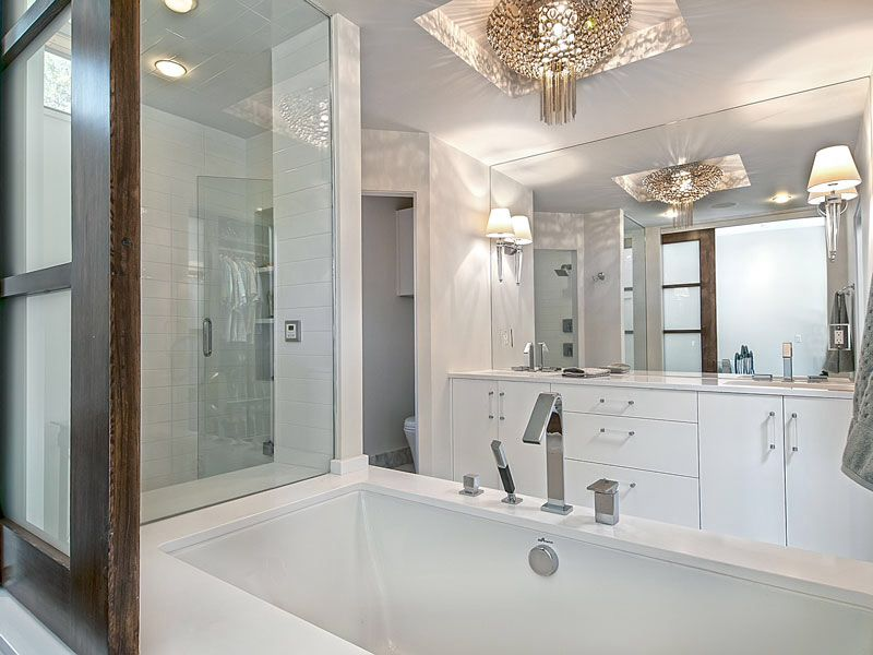 Contemporary Master Bathroom with Shoji door, Casement, Bathtub, Corian counters, Undermount sink, drop in bathtub, Shower