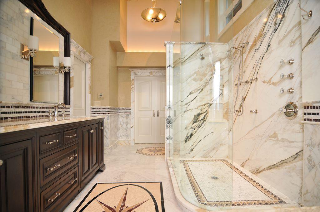 Traditional Master Bathroom with Raised panel, Pendant light, frameless showerdoor, High ceiling, Handheld showerhead, Flush