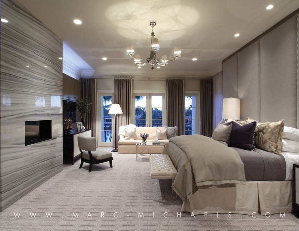 contemporary master bedroom with crown molding stone fireplace