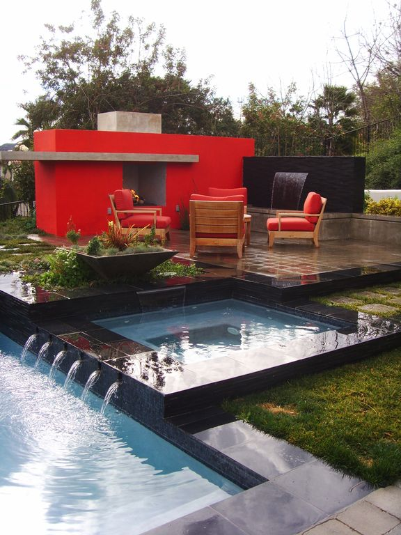 Contemporary Swimming Pool with exterior tile floors, Raised beds, Pathway, Fountain, Other Pool Type, Deck Railing