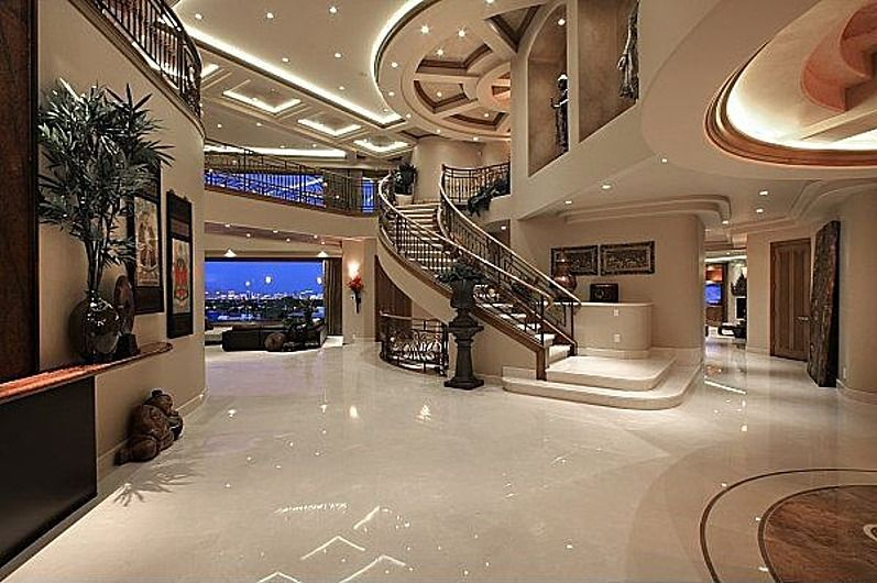 Traditional Entryway with complex marble floors, can lights, Box ceiling, High ceiling, Loft, Paint
