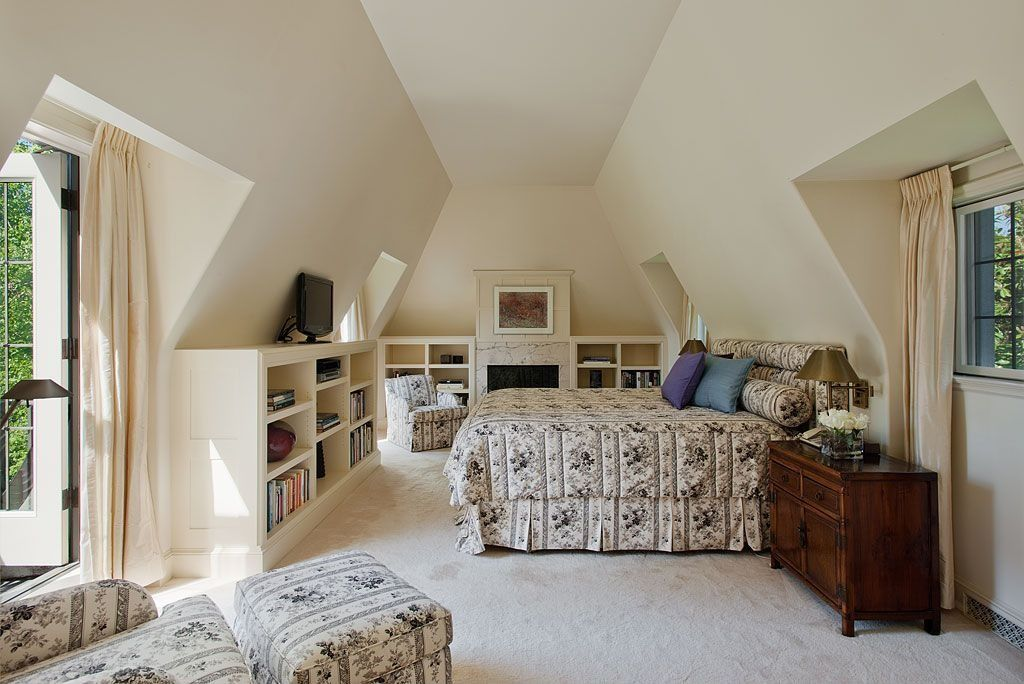 Traditional Master Bedroom with Built-in bookshelf, stone fireplace, French doors, Carpet
