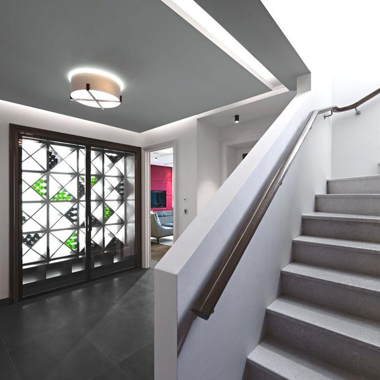 Contemporary Wine Cellar with soapstone tile floors, flush light, stone tile floors, Standard height