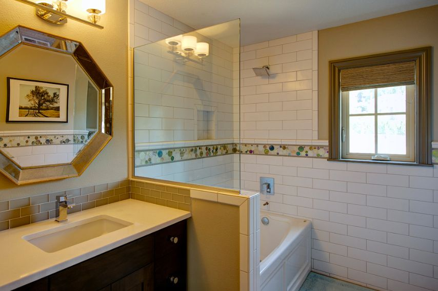 Modern Kids Bathroom with Wall Tiles, Flat panel cabinets, shower bath combo, Simple marble counters, partial backsplash