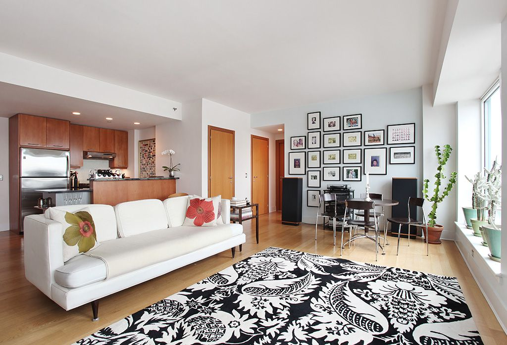 Contemporary Great Room with can lights, picture window, Laminate floors, Standard height, flat door, Built-in bookshelf