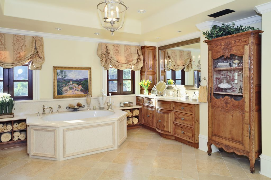 Traditional Master Bathroom with Crown molding, flush light, Undermount sink, linen and towel storage cabinet, Flush, Bathtub