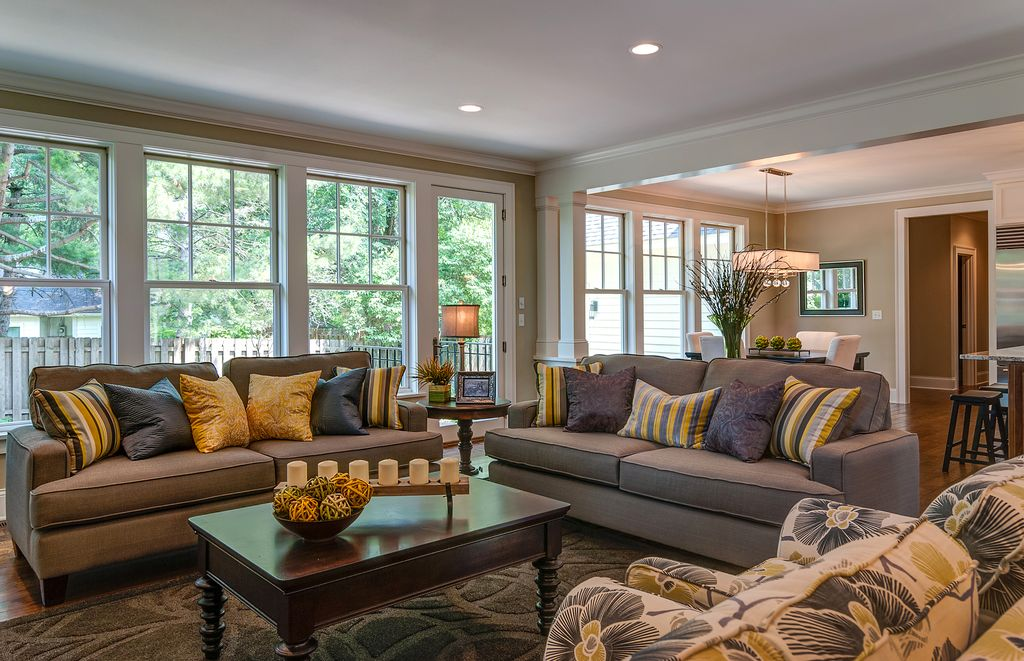Traditional Living Room with Schnadig american kaleidoscope coffee table, French doors, Area rug, Hardwood floors, Columns