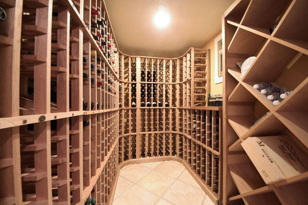 Modern Wine Cellar with stone tile floors, flush light, Casement, Standard height, sandstone tile floors