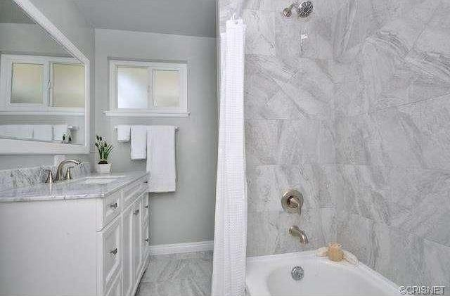 Traditional Full Bathroom with Flat panel cabinets, Standard height, stone tile floors, drop in bathtub, Casement, Bathtub