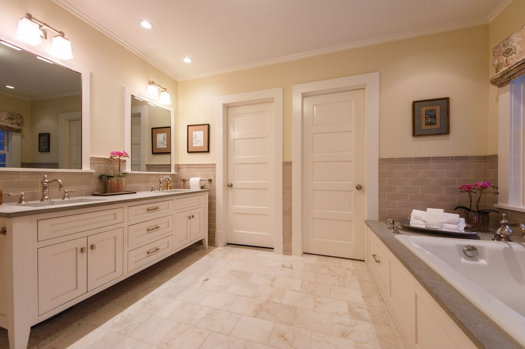 Traditional Master Bathroom with Master bathroom, double-hung window, Flat panel cabinets, Stone Tile, Bathtub, can lights