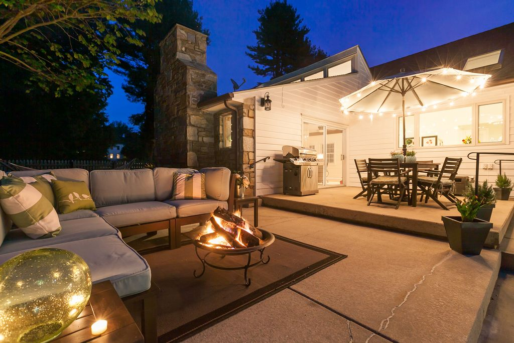 Contemporary Patio with Outdoor kitchen, Skylight, exterior concrete tile floors, picture window, Fence, Fire pit