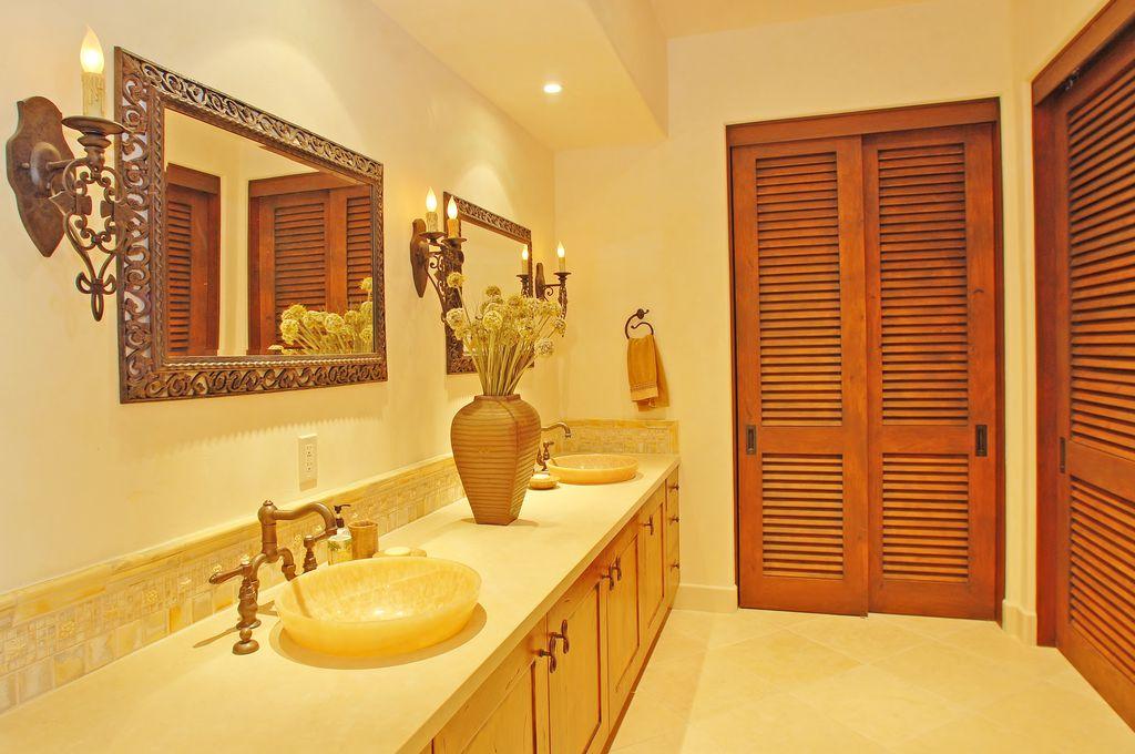 Mediterranean Full Bathroom with Ceramic Tile, Stone Tile, Double sink, partial backsplash, Louvered door, can lights