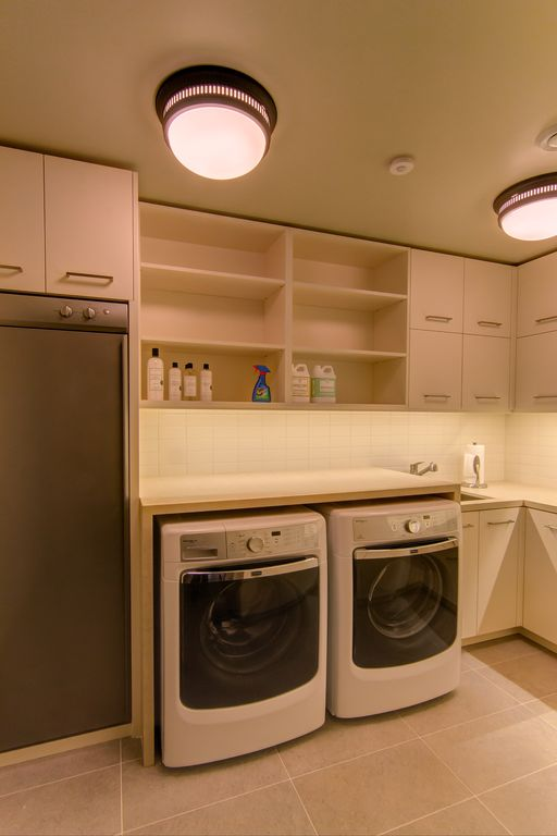 Eclectic Laundry Room with laundry sink, sandstone tile floors, Standard height, stone tile floors, flush light, can lights