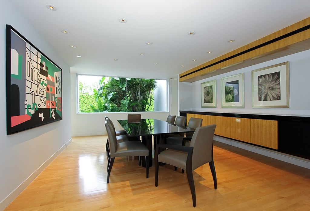 Contemporary Dining Room with Laminate floors, Standard height, Built-in bookshelf, can lights, picture window