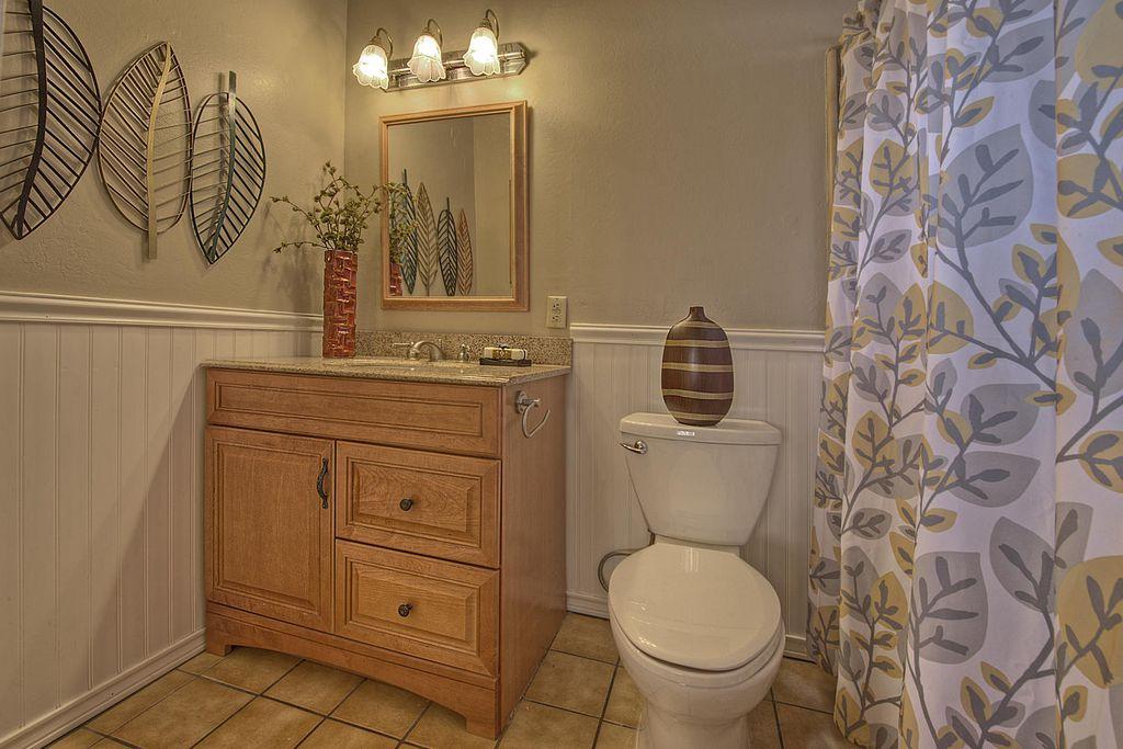 Cottage Full Bathroom with stone tile floors, Undermount sink, Home Depot 32 sf Beadboard White V-Groove Panel, Raised panel