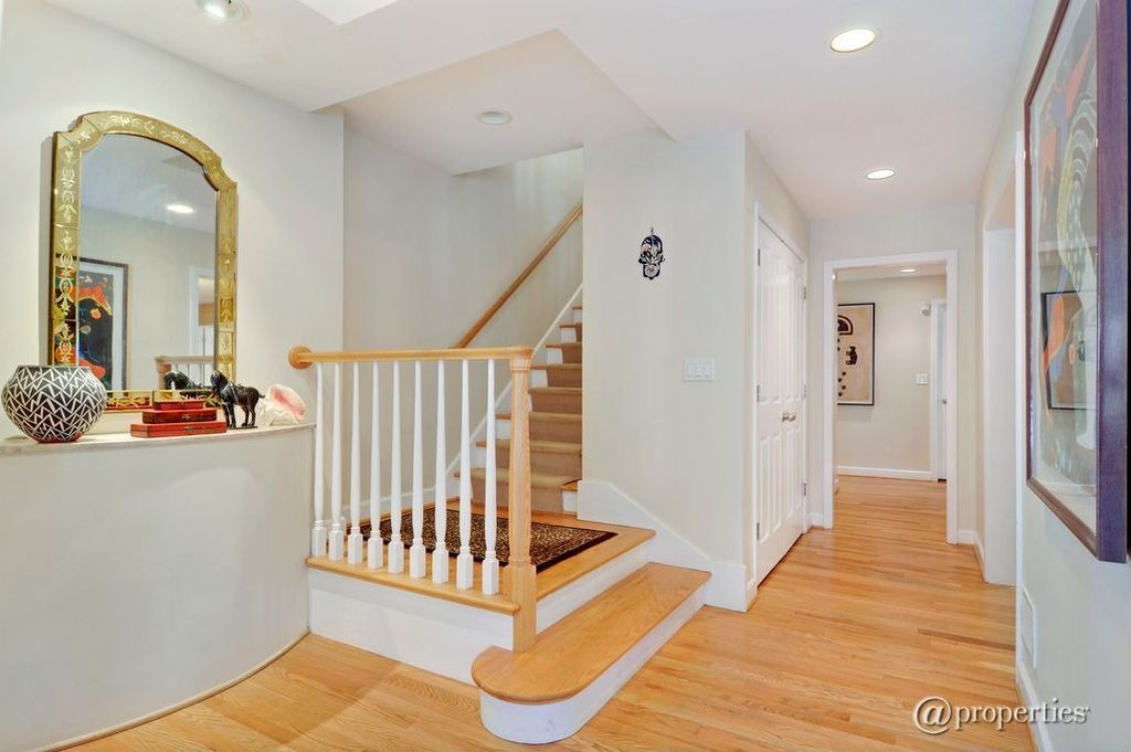 Traditional Entryway with Standard height, can lights, Hardwood floors