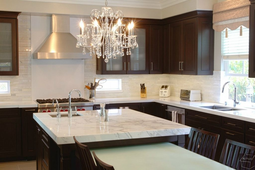 Contemporary Kitchen with Glass panel, Stainless undermount 2-basin sink, Chandelier, Carrara marble countertop, Limestone