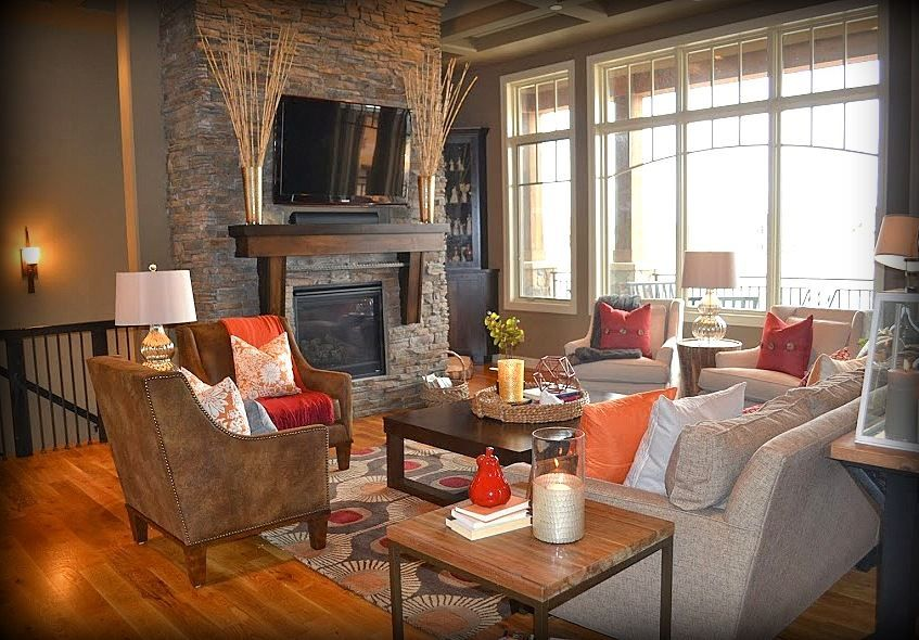Contemporary Living Room with Box ceiling, stone fireplace, Hardwood floors, Fireplace, Casement, Paint 1, Built-in bookshelf