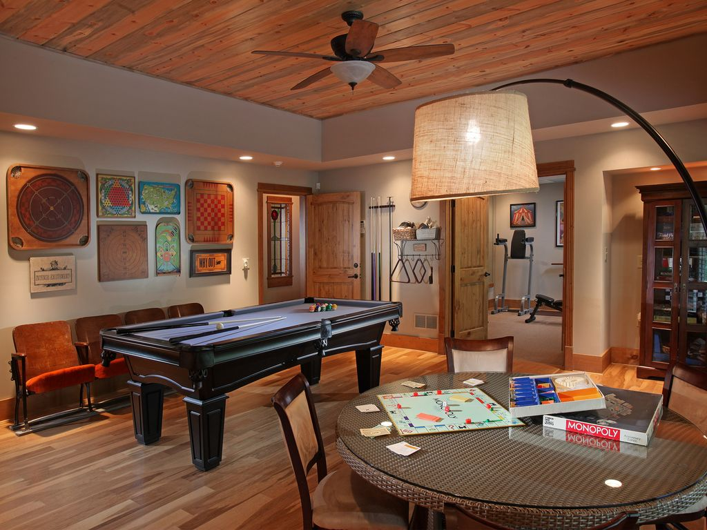 Craftsman Game Room with specialty door, Laminate floors, Standard height, can lights, flush light, Ceiling fan