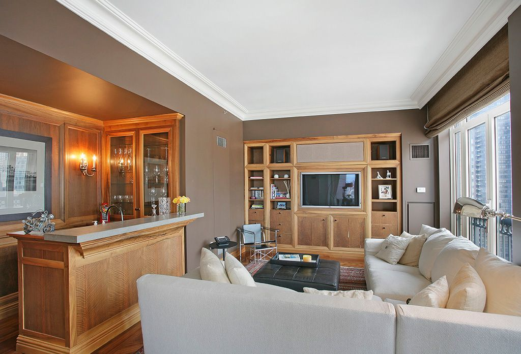 Contemporary Living Room with Hardwood floors, Crown molding, picture window, Standard height, Built-in bookshelf