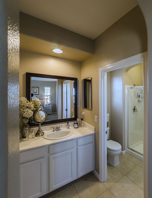 Traditional 3/4 Bathroom with Inset cabinets, Handheld showerhead, drop-in sink, stone tile floors, full backsplash, Shower