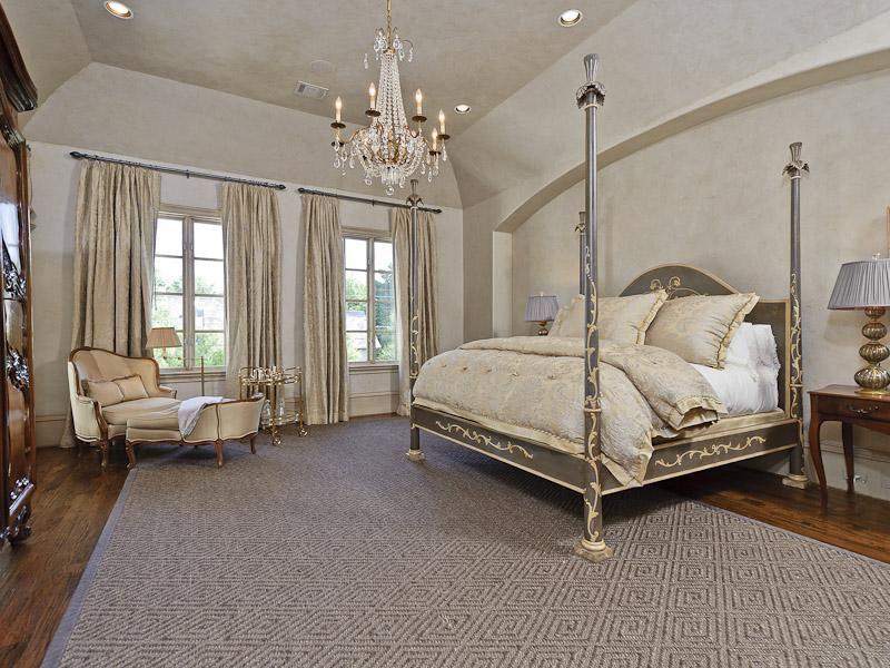 Traditional Master Bedroom with Hardwood floors, Chandelier, Casement, Standard height, can lights