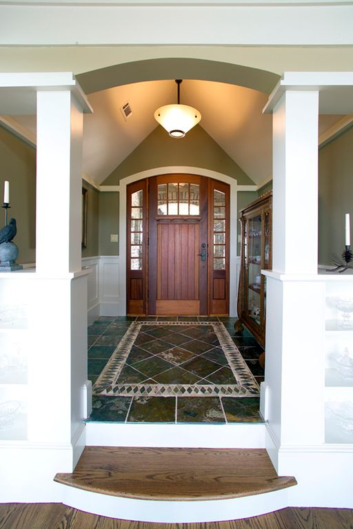 Craftsman Entryway with Built-in bookshelf, Chair rail, Sunrise french doors collection with antique cherry finish