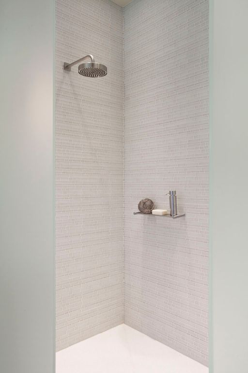 Contemporary 3/4 Bathroom with Floor to ceiling shower tile, Brushed nickel rain showerhead, Brushed nickel soap dispenser