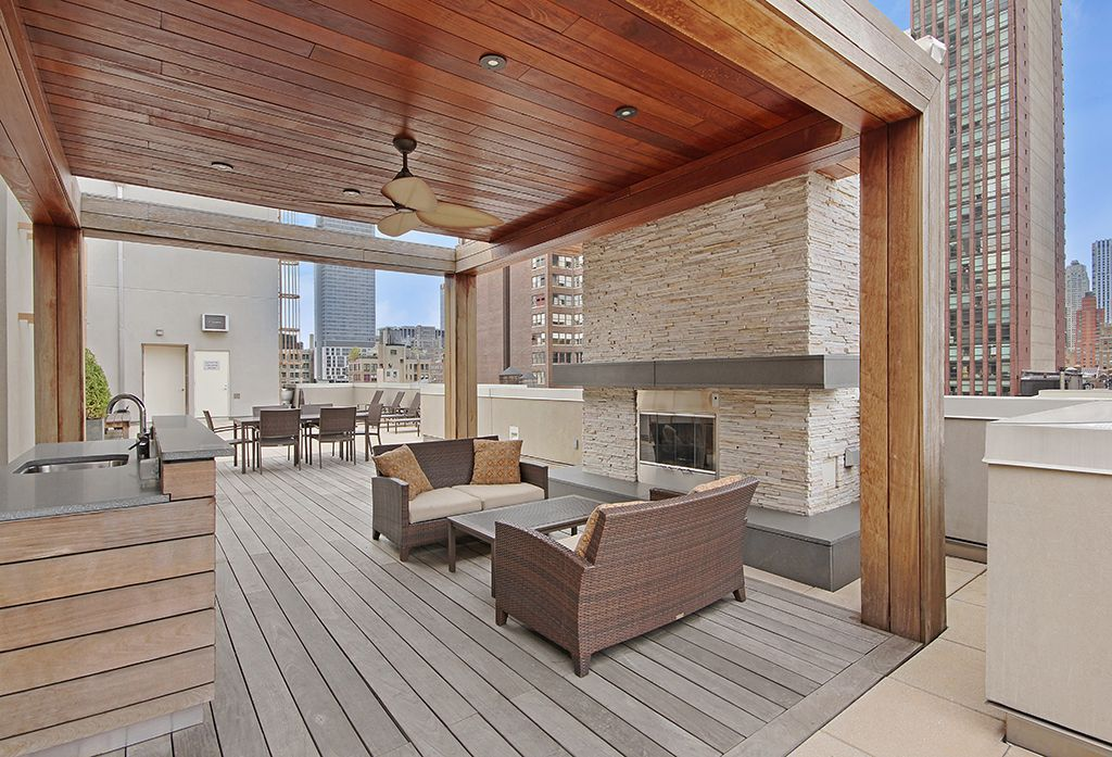 Contemporary Deck with Ballard design sutton loveseat, Outdoor fireplace, Outdoor kitchen, Trellis, Deck Railing
