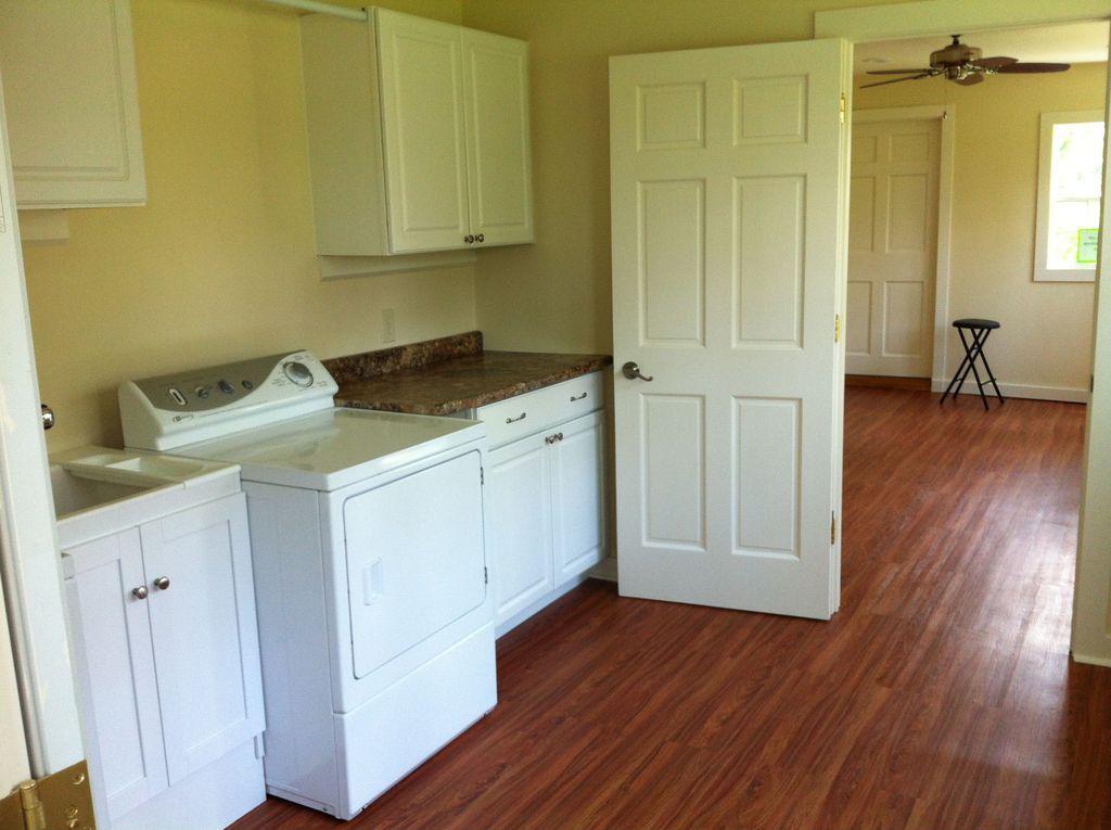 Traditional Laundry Room with Hardwood floors, Undermount sink, Built-in bookshelf