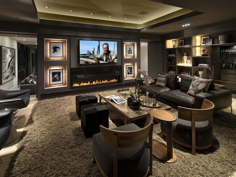 Traditional Home Theater with insert fireplace, can lights, sandstone floors, Standard height, Fireplace, Built-in bookshelf