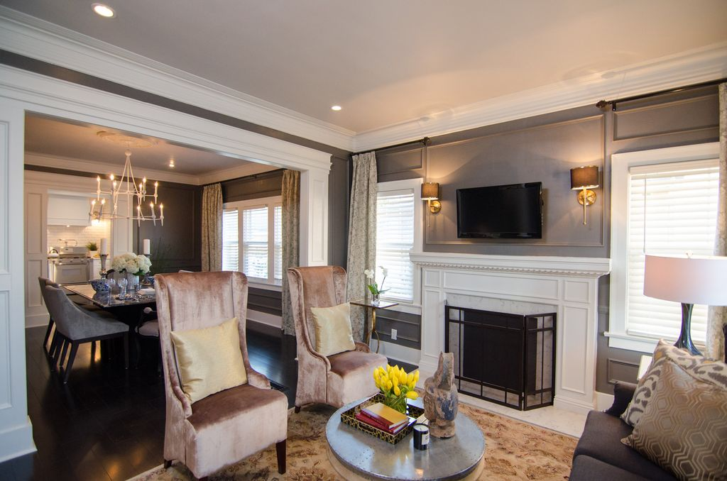 Traditional Living Room with Fireplace, Standard height, double-hung window, can lights, Hardwood floors, metal fireplace
