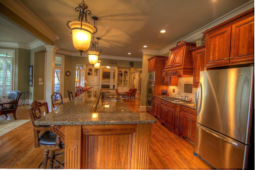 Traditional Kitchen with Crown molding, arizona tile, GIALLO VENEZIANO, granite, Multiple Refrigerators, Limestone Tile
