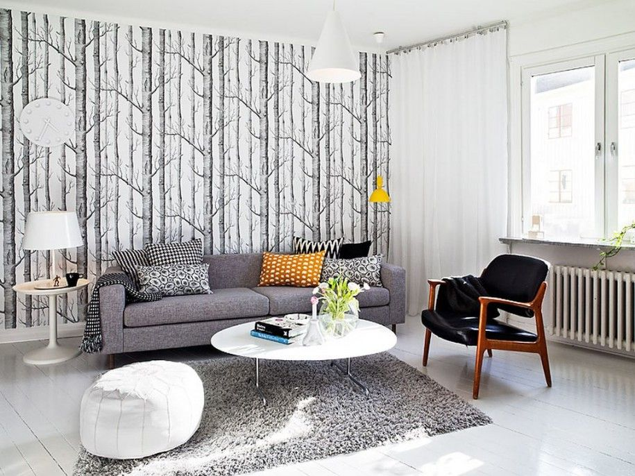 Contemporary Living Room with Pendant light, Hardwood floors, Faux leather pouf, interior wallpaper, Standard height