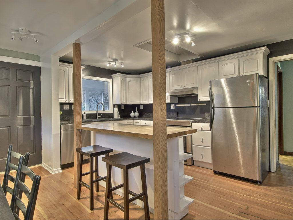 Traditional Kitchen with six panel door, Freestanding Full Size Top Freezer Refrigerator, Kitchen island, Undermount sink