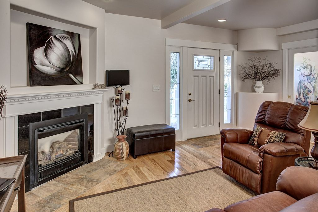 Traditional Living Room with Standard height, Glass panel door, Exposed beam, can lights, Hardwood floors, French doors