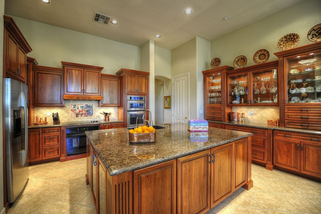Traditional Kitchen with Limestone Tile, Kitchen island, gas range, Built In Refrigerator, Framed Partial Panel, Raised panel
