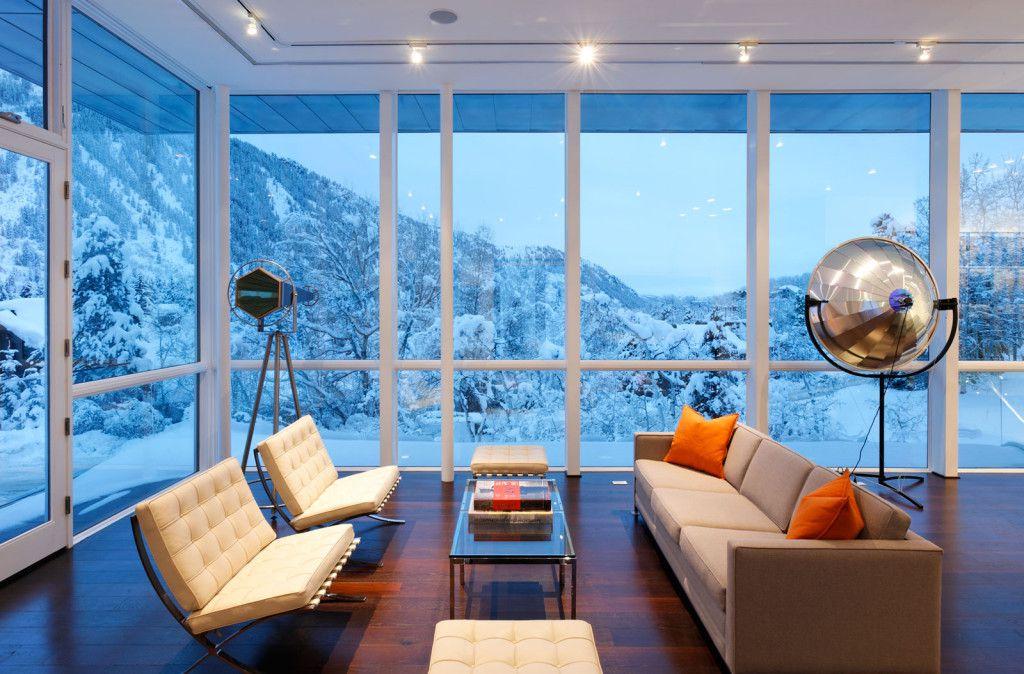 Modern Living Room with Standard height, Paint 1, Barcelona chair and ottoman, flush light, Hardwood floors, Transom window