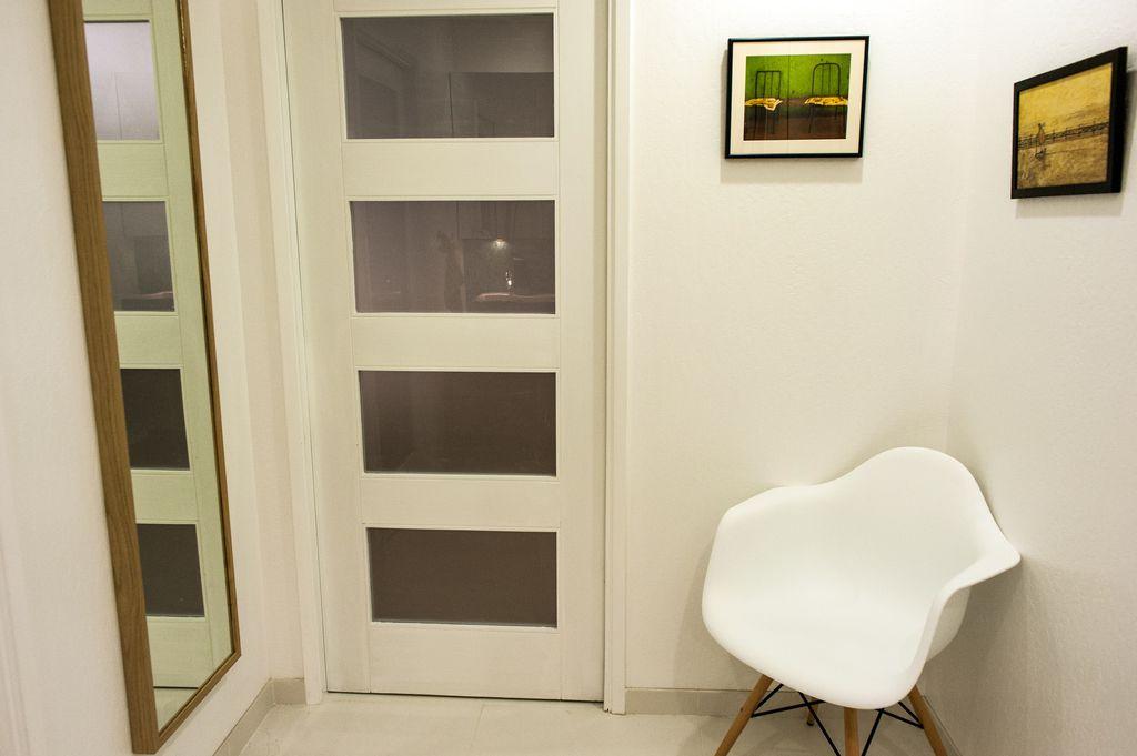 Modern Hallway with sandstone tile floors, stone tile floors, specialty door, Standard height