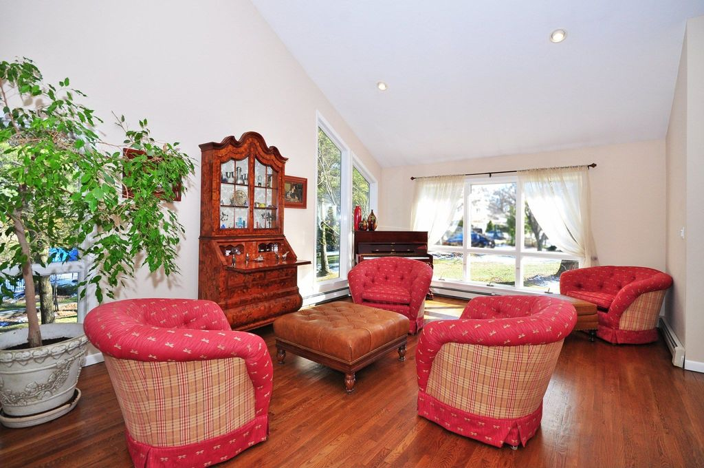 Country Living Room with picture window, Casement, Standard height, Hardwood floors, can lights