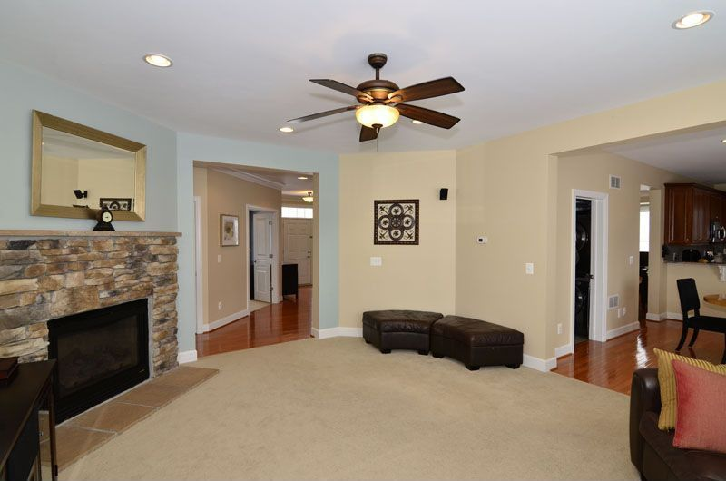 Traditional Living Room with Fireplace, Carpet, can lights, Standard height, Ceiling fan, stone fireplace