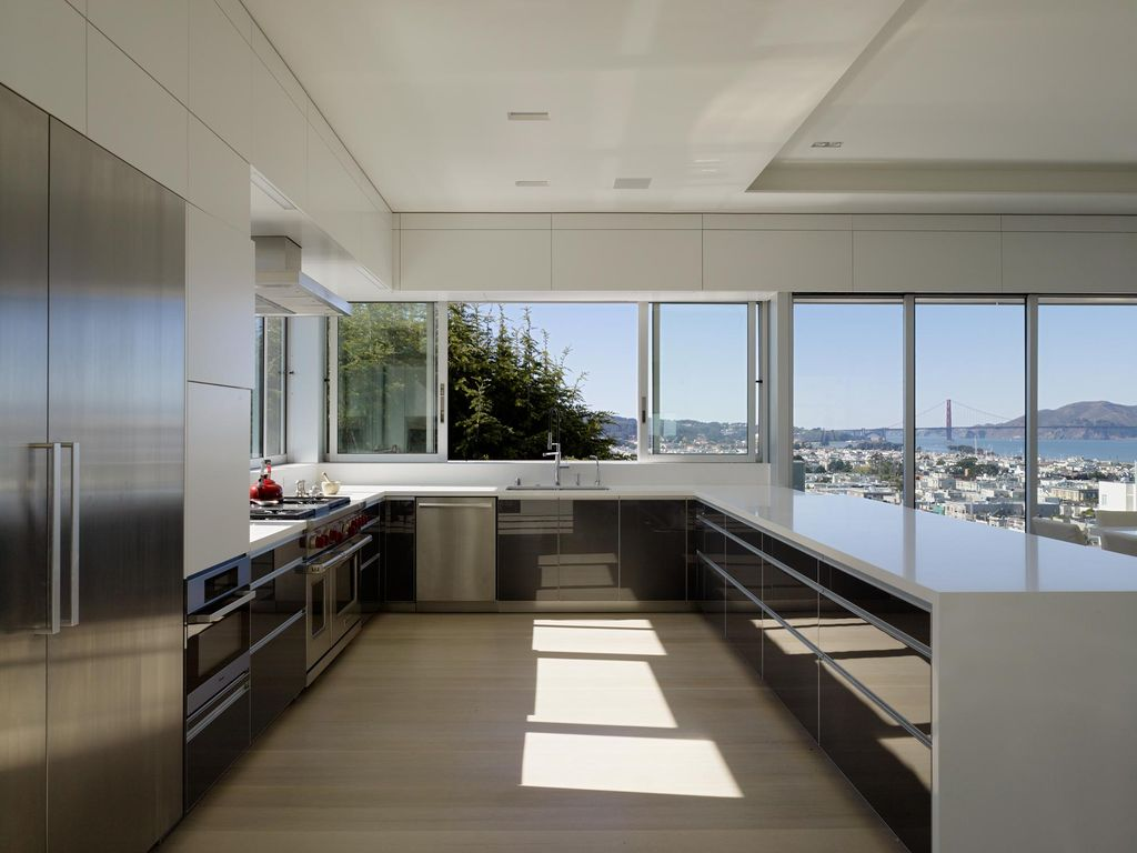 Contemporary Kitchen with wall oven, Flush, double oven range, Built In Refrigerator, Corian counters, European Cabinets